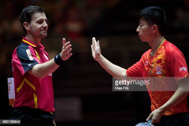 Ma Long of China and Timo Boll of Germany celebrate after Men Double 1 Round at Table Tennis World Championship at Messe Duesseldorf on May 30 2017...