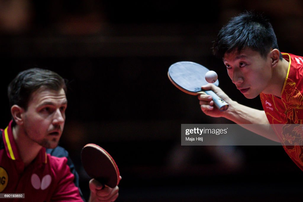 Ma Long of China and Timo Boll of Germany (L) compete during Men Double 1. Round at Table Tennis World Championship at Messe Duesseldorf on May 30, 2017 in Dusseldorf, Germany.