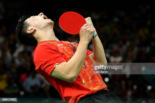 Ma Long of China celebrates after winning his Mens Table Tennis Singles Semifinal match against Jun Mizutani of Japan at Rio Centro on August 11 2016...