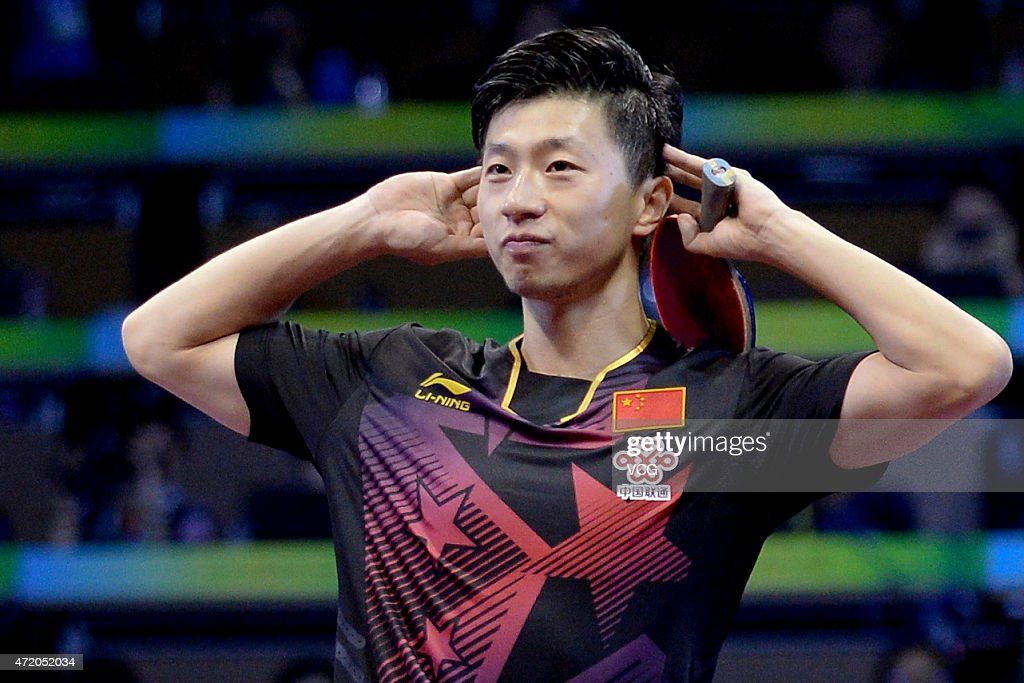 Ma Long of China celebrates after winning men's singles final match against Fang Bo of China on day eight of the 2015 World Table Tennis Championships at the Suzhou International Expo Center on May 3, 2015 in Suzhou, China.