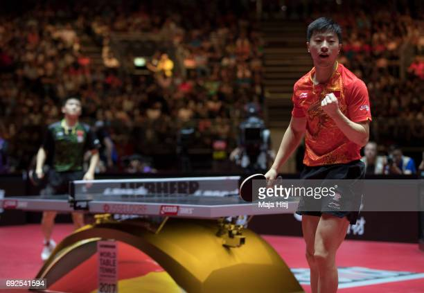 Ma Long of China celebrates against Zhendong Fan of China during Men's Singles Final at Table Tennis World Championship at Messe Duesseldorf on June...