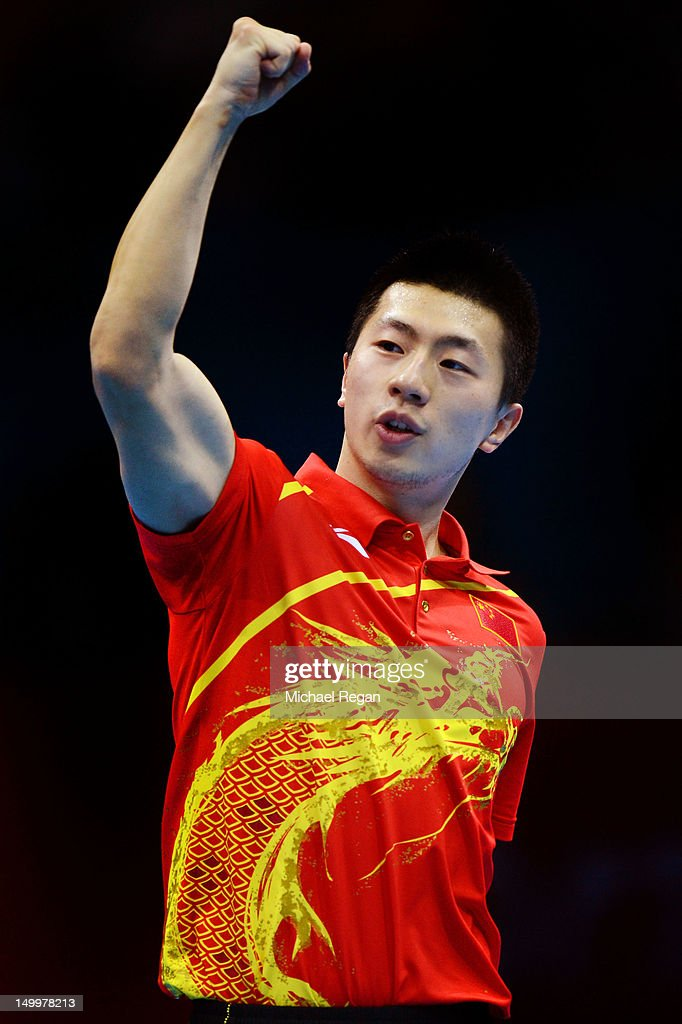 Ma Long of China celebrates winning 3-1 against Seungmin Ryu of Korea during the Men's Team Table Tennis gold medal match on Day 12 of the London 2012 Olympic Games at ExCeL on August 8, 2012 in London, England.
