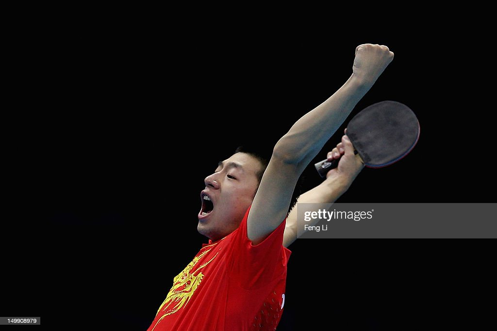 <a gi-track='captionPersonalityLinkClicked' href=/galleries/search?phrase=Ma+Long+-+Table+Tennis+Player&family=editorial&specificpeople=2158981 ng-click='$event.stopPropagation()'>Ma Long</a> of China celebrates winning Men's Team Table Tennis semifinal match against team of Germany on Day 10 of the London 2012 Olympic Games at ExCeL on August 6, 2012 in London, England.