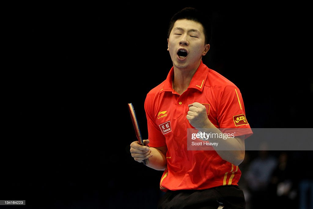 <a gi-track='captionPersonalityLinkClicked' href=/galleries/search?phrase=Ma+Long&family=editorial&specificpeople=2158981 ng-click='$event.stopPropagation()'>Ma Long</a> of China celebrates winning the Men's Singles Final against Zhang Jike during day four of the ITTF Pro Tour Table Tennis Grand Finals at ExCel on November 27, 2011 in London, England.