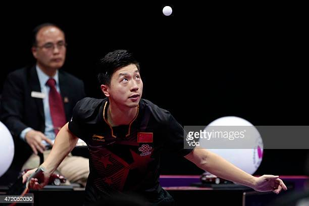 Ma Long of China competes against Fang Bo of China during men's singles final match on day eight of the 2015 World Table Tennis Championships at the...
