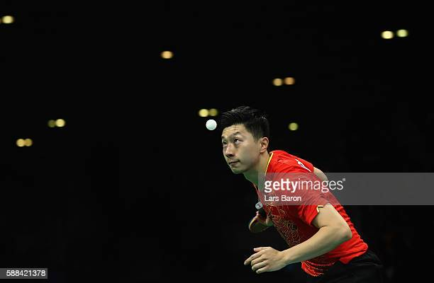 Ma Long of China competes during the Mens Table Tennis Singles Semifinal match between Ma Long of China and Jun Mizutani of Japan at Rio Centro on...