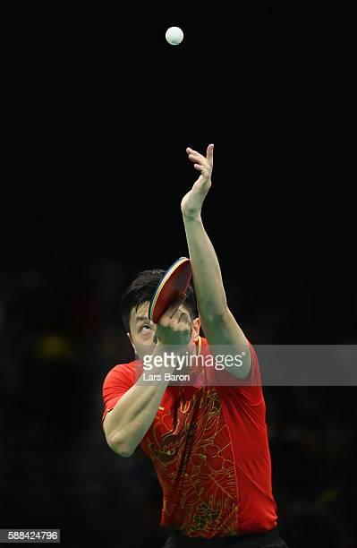 Ma Long of China competes during the Mens Table Tennis Singles Semifinal match between Ma Long of China and Jun Mizutani of Japan at Rio Centro on...