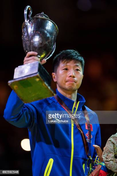Ma Long of China holds the trophy after winning the Men's Singles Final match of the Table Tennis World Championship at Messe Duesseldorf on June 5...