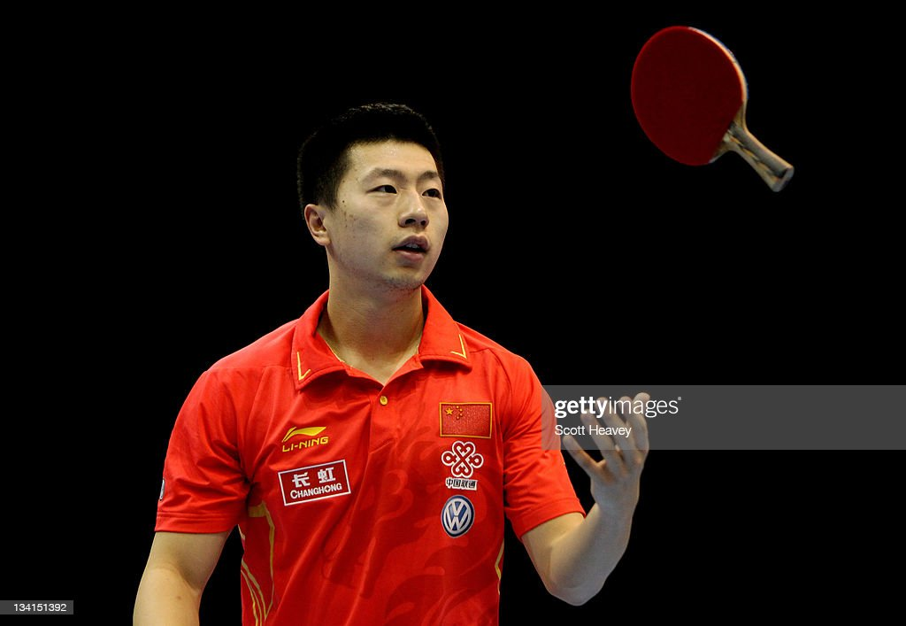 <a gi-track='captionPersonalityLinkClicked' href=/galleries/search?phrase=Ma+Long&family=editorial&specificpeople=2158981 ng-click='$event.stopPropagation()'>Ma Long</a> of China in action against Wang Hao during the Men's Singles Semi Final match during day four of the ITTF Pro Tour Table Tennis Grand Finals at ExCel on November 27, 2011 in London, England.
