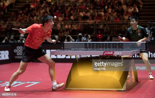 Ma Long of China in action against Zhendong Fan of China during Men's Singles Final at Table Tennis World Championship at Messe Duesseldorf on June 5...