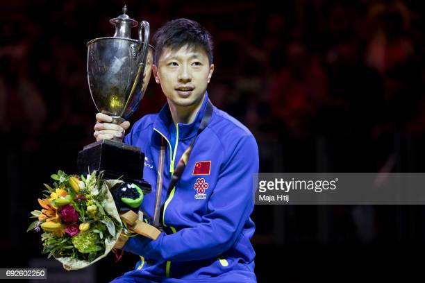 Ma Long of China poses with a trophy during celebration ceremony of Men's Singles Final at Table Tennis World Championship at Messe Duesseldorf on...