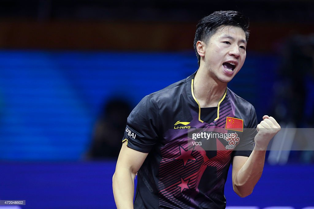 Ma Long of China reacts against Fang Bo of China during men's singles final match on day eight of the 2015 World Table Tennis Championships at the Suzhou International Expo Center on May 3, 2015 in Suzhou, China.