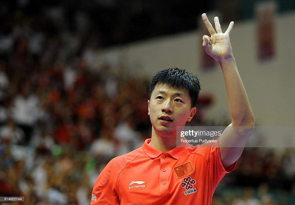 <a gi-track='captionPersonalityLinkClicked' href=/galleries/search?phrase=Ma+Long+-+Table+Tennis+Player&family=editorial&specificpeople=2158981 ng-click='$event.stopPropagation()'>Ma Long</a> of China reacts against Maharu Yoshimura of Japan during the 2016 World Table Tennis Championship Men's Team Division final match at Malawati Stadium on March 6, 2016 in Shah Alam, Malaysia.