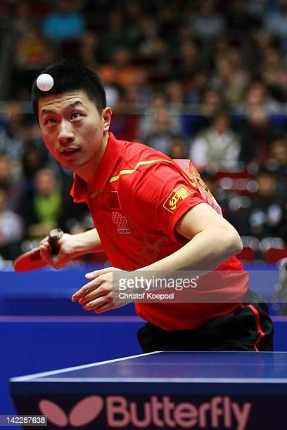 Ma Long of China serves during his match against Timo Boll of Germany during the LIEBHERR table tennis team world cup 2012 championship division...