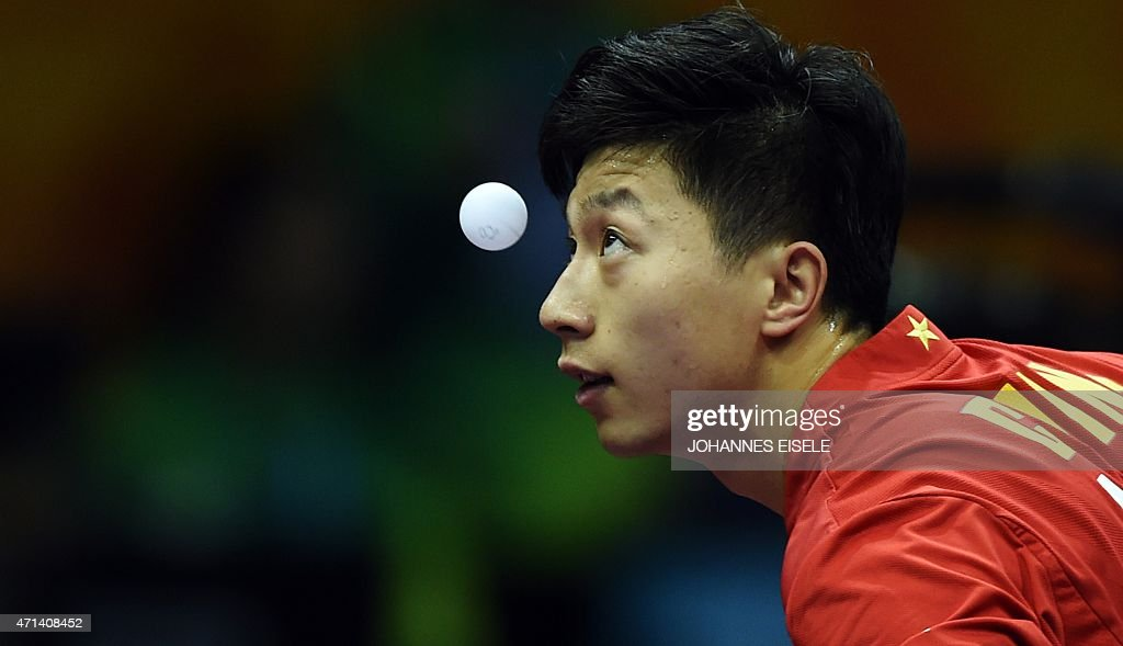 <a gi-track='captionPersonalityLinkClicked' href=/galleries/search?phrase=Ma+Long&family=editorial&specificpeople=2158981 ng-click='$event.stopPropagation()'>Ma Long</a> of China serves during his men's single match against Noshad Alamiyan of Iran at the 2015 World Table Tennis Championships at the Suzhou International Expo Center in Suzhou, Jiangsu province on April 28, 2015.