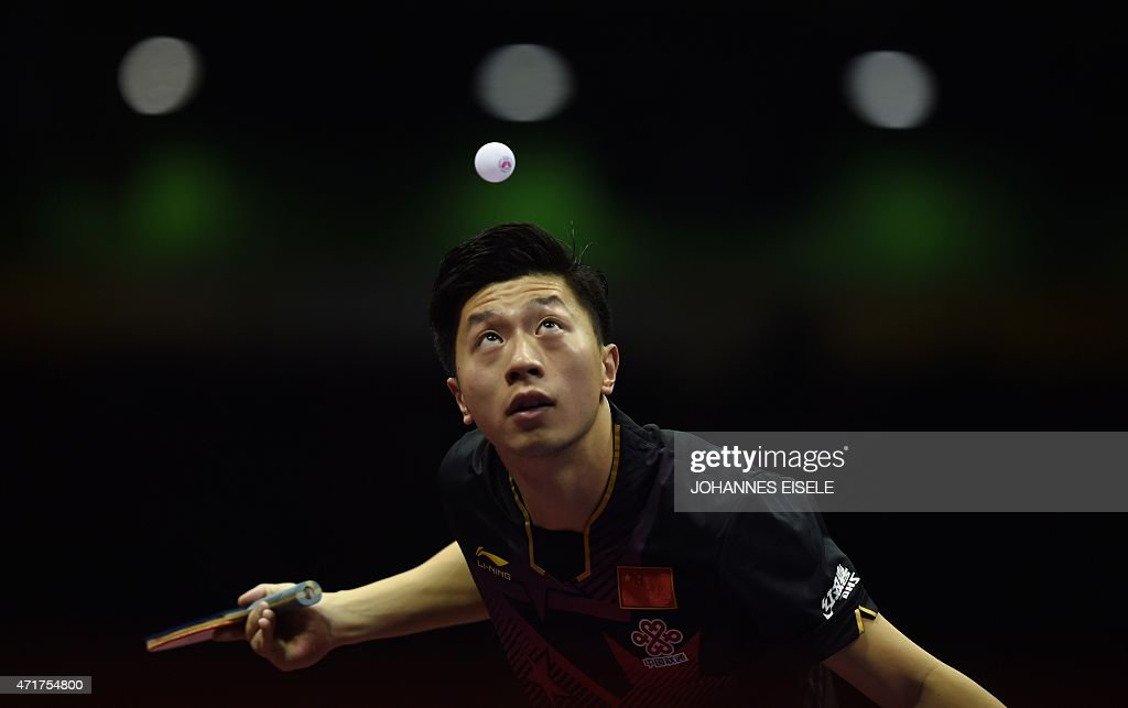 <a gi-track='captionPersonalityLinkClicked' href=/galleries/search?phrase=Ma+Long+-+Table+Tennis+Player&family=editorial&specificpeople=2158981 ng-click='$event.stopPropagation()'>Ma Long</a> of China serves during his men's singles match against Joo Saehyuk of South Korea at the 2015 World Table Tennis Championships at the Suzhou International Expo Center in Suzhou, Jiangsu province on May 1, 2015.