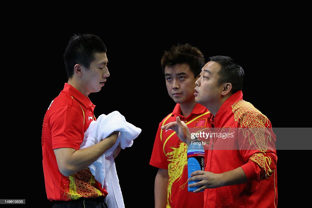<a gi-track='captionPersonalityLinkClicked' href=/galleries/search?phrase=Ma+Long+-+Table+Tennis+Player&family=editorial&specificpeople=2158981 ng-click='$event.stopPropagation()'>Ma Long</a> of China speaks with coach <a gi-track='captionPersonalityLinkClicked' href=/galleries/search?phrase=Liu+Guoliang&family=editorial&specificpeople=655363 ng-click='$event.stopPropagation()'>Liu Guoliang</a> as Wang Hao standing by during Men's Team Table Tennis semifinal match against team of Germany on Day 10 of the London 2012 Olympic Games at ExCeL on August 6, 2012 in London, England.