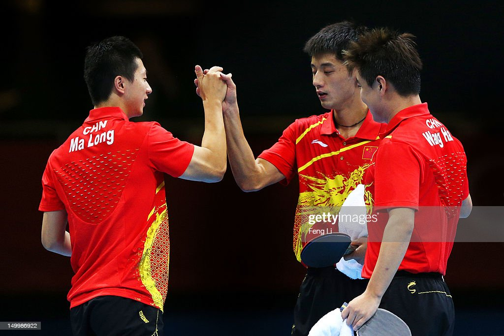 Ma Long, Wang Hao and Zhang Jike of China celebrate defeating Korea to win the Men's Team Table Tennis gold medal match on Day 12 of the London 2012 Olympic Games at ExCeL on August 8, 2012 in London, England.