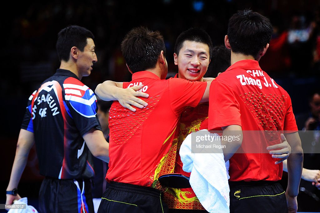<a gi-track='captionPersonalityLinkClicked' href=/galleries/search?phrase=Ma+Long&family=editorial&specificpeople=2158981 ng-click='$event.stopPropagation()'>Ma Long</a> (2nd R), Wang Hao (2nd L) and <a gi-track='captionPersonalityLinkClicked' href=/galleries/search?phrase=Zhang+Jike&family=editorial&specificpeople=4979400 ng-click='$event.stopPropagation()'>Zhang Jike</a> (R) of China celebrate defeating Korea to win the Men's Team Table Tennis gold medal match on Day 12 of the London 2012 Olympic Games at ExCeL on August 8, 2012 in London, England.