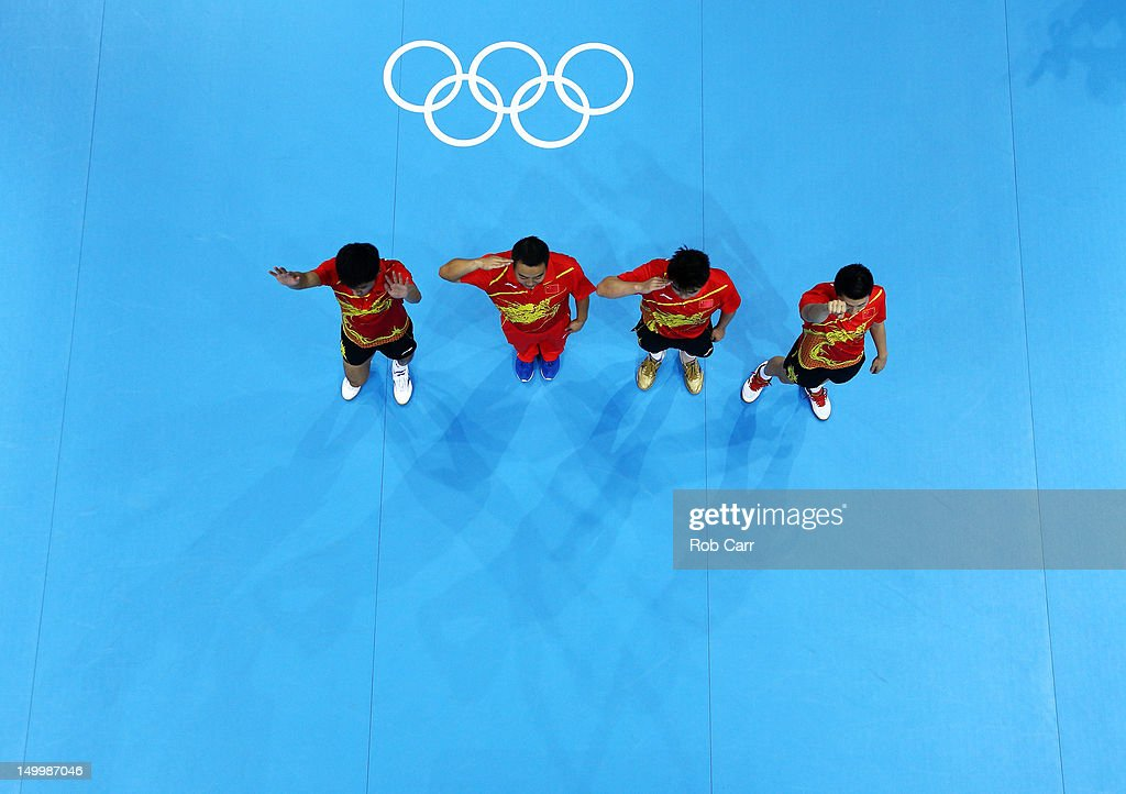 Ma Long, Wang Hao, Coach Liu Guoliang and Zhang Jike of China celebrate defeating Korea to win the Men's Team Table Tennis gold medal match on Day 12 of the London 2012 Olympic Games at ExCeL on August 8, 2012 in London, England.
