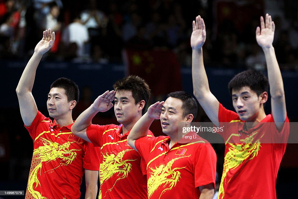 <a gi-track='captionPersonalityLinkClicked' href=/galleries/search?phrase=Ma+Long&family=editorial&specificpeople=2158981 ng-click='$event.stopPropagation()'>Ma Long</a>, Wang Hao, Coach <a gi-track='captionPersonalityLinkClicked' href=/galleries/search?phrase=Liu+Guoliang&family=editorial&specificpeople=655363 ng-click='$event.stopPropagation()'>Liu Guoliang</a> and <a gi-track='captionPersonalityLinkClicked' href=/galleries/search?phrase=Zhang+Jike&family=editorial&specificpeople=4979400 ng-click='$event.stopPropagation()'>Zhang Jike</a> of China celebrate defeating Korea to win the Men's Team Table Tennis gold medal match on Day 12 of the London 2012 Olympic Games at ExCeL on August 8, 2012 in London, England.