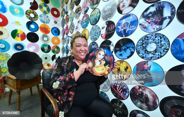 Ma Nerriza dela Cerna of Erika Records displays a full color 'Beauty and the Beast' record at the company's office in Buena Park California on April...