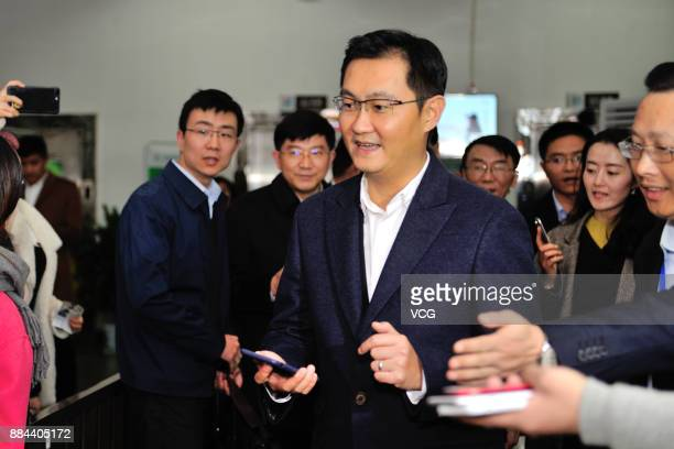 Ma ''Pony'' Huateng chairman and chief executive officer of Tencent Holdings Ltd walks through the ticeket gate after scanning a QR code with WeChat...