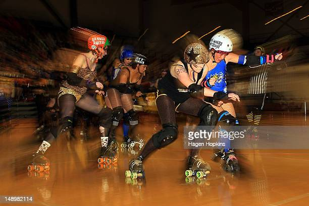 Ma Whero Mischief of Comic Slams Scarface Clawdia of Smash Malice collide during the Richter City Roller Derby Season Grand Final at TSB Arena on...