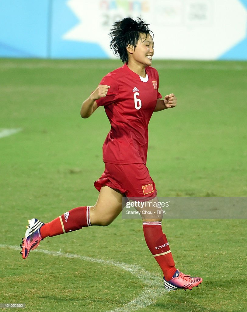 Ma Xiaolan of China celebrates after she scored from the penalty spot in the penalty shoot out after the full time scorelss draw during the 2014 FIFA Girls Summer Youth Olympic Football Tournament Semi Final match between China and Slovakia at Wutaishan Stadium on August 23, 2014 in Nanjing, China.