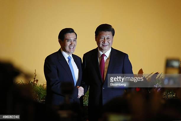 Ma Yingjeou Taiwan's president left and Xi Jinping China's president shake hands during a photo session ahead of their meeting in Singapore on...