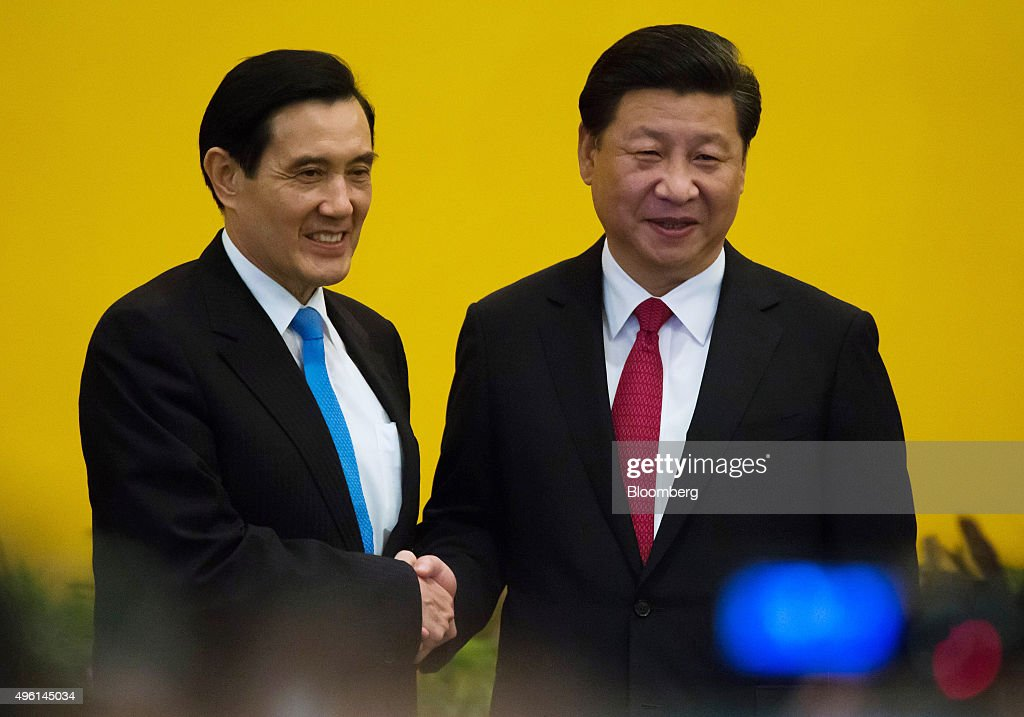 Ma Ying-jeou, Taiwan's president, left, and <a gi-track='captionPersonalityLinkClicked' href=/galleries/search?phrase=Xi+Jinping&family=editorial&specificpeople=2598986 ng-click='$event.stopPropagation()'>Xi Jinping</a>, China's president, shake hands during a photo session ahead of their meeting in Singapore, on Saturday, Nov. 7, 2015. The leaders of China and Taiwan started a carefully managed meeting in Singapore that marks the first summit since the two sides clashed in a civil war seven decades ago. Photographer: Tomohiro Ohsumi/Bloomberg via Getty Images