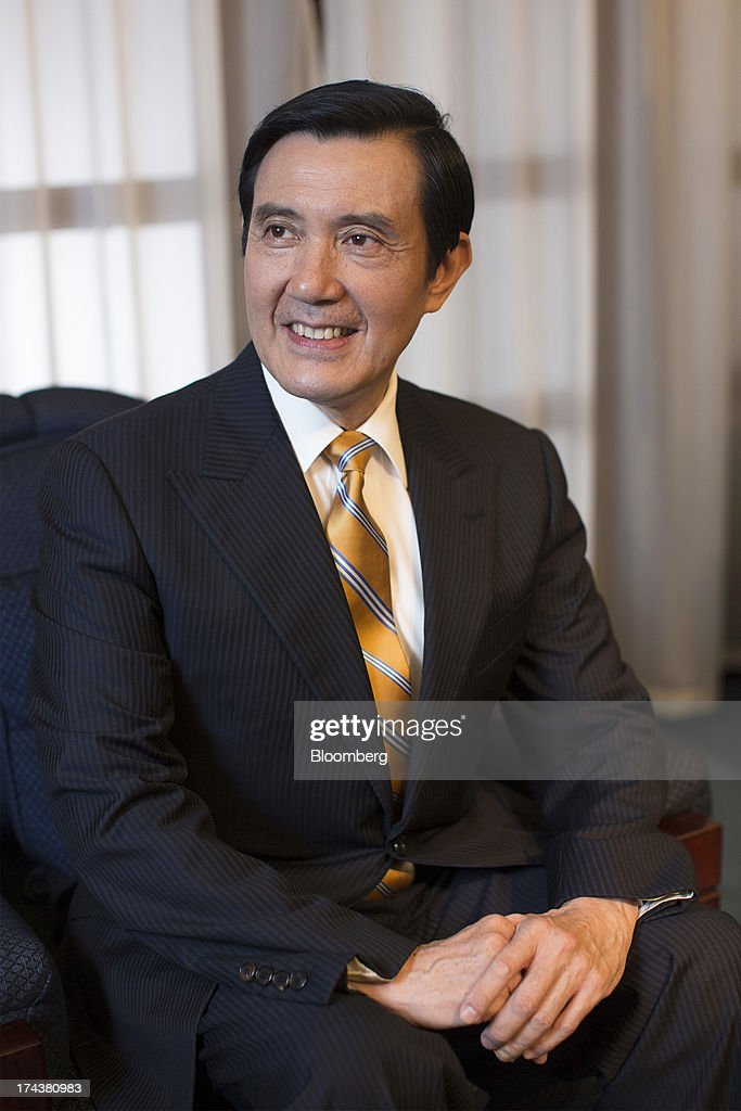 <a gi-track='captionPersonalityLinkClicked' href=/galleries/search?phrase=Ma+Ying-jeou&family=editorial&specificpeople=539998 ng-click='$event.stopPropagation()'>Ma Ying-jeou</a>, Taiwan's president, poses for a photograph after an interview in the presidential palace in Taipei, Taiwan, on Thursday, July 25, 2013. Ma ruled out driving down the Taiwan dollar to boost exports following the currencys rally against the yen and said the government still aims for growth of at least 2 percent this year. Photographer: Jerome Favre/Bloomberg via Getty Images
