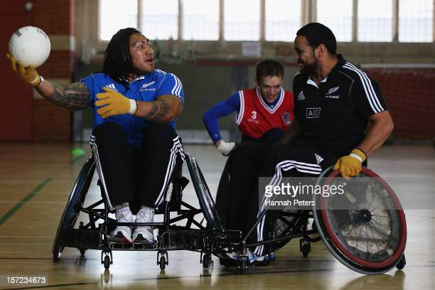 Ma'a Nonu and Piri Weepu of the All Blacks take part in a wheelchair rugby match at the Harrow Club on November 30 2012 in London England