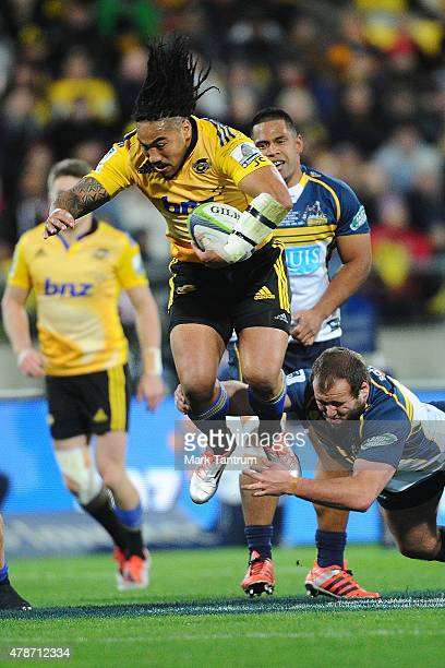 Ma'a Nonu breaks a tackle during the Super Rugby Semi Final match between the Hurricanes and the Brumbies at Westpac Stadium on June 27 2015 in...