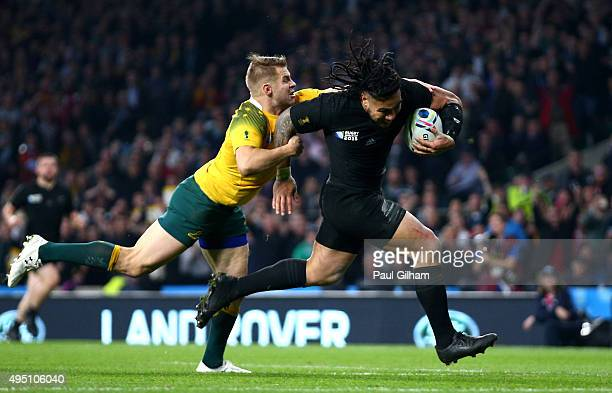 Ma'a Nonu of New Zealand breaks the tackle of Drew Mitchell of Australia on his way to score his team's second try during the 2015 Rugby World Cup...