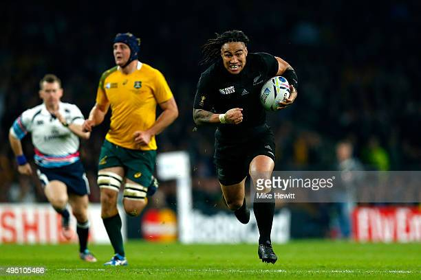 Ma'a Nonu of New Zealand breaks through on his way to score his team's second try during the 2015 Rugby World Cup Final match between New Zealand and...