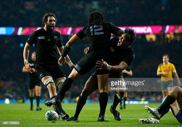 Ma'a Nonu of New Zealand celebrates scoring his team's second try with Julian Savea of New Zealand and Sam Whitelock of New Zealand during the 2015...