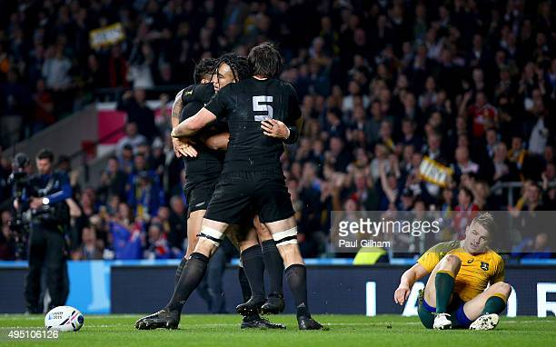 Ma'a Nonu of New Zealand celebrates scoring his team's second try with Sam Whitelock of New Zealand and Julian Savea of New Zealand during the 2015...
