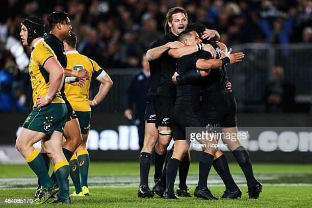 Ma'a Nonu of the All Blacks is congratulated by teammates Richie McCaw and Aaron Smith during The Rugby Championship Bledisloe Cup match between the...
