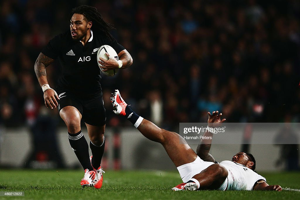 Ma'a Nonu of the All Blacks runs over Manusamoa Tuilagi of England during the International Test Match between the New Zealand All Blacks and England...