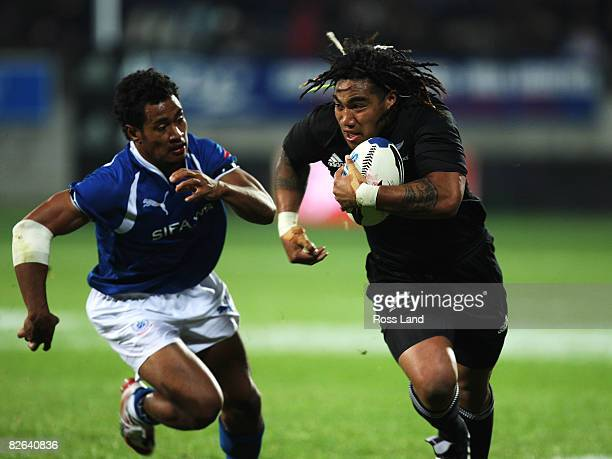 Ma'a Nonu of the All Blacks runs through the tackle of Esera Lauina during the rugby test match between New Zealand and Samoa at Yarrows Stadium on...