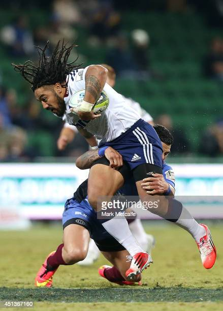 Ma'a Nonu of the Blues is tackled during the round 17 Super Rugby match between the Force and the Blues at nib Stadium on June 28 2014 in Perth...