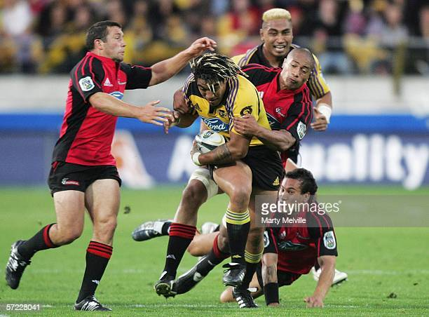 Ma'a Nonu of the Hurricanes gets tackled by Aaron Mauger and Ross Filipo of the Crusaders during the round eight Super 14 match between the...