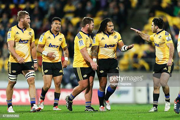Ma'a Nonu of the Hurricanes is congratulated on his try by teammates Reggie Goodes and Nehe MilnerSkudder during the round 14 Super Rugby match...