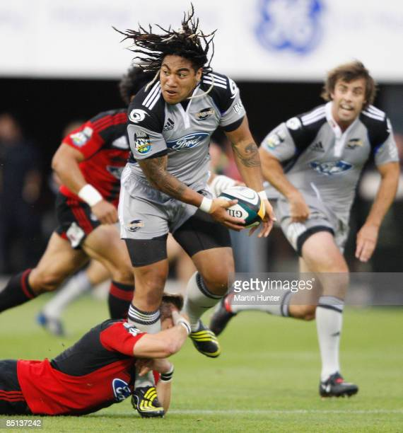 Ma'a Nonu of the Hurricanes is tackled by Richie McCaw of the Crusaders during the round three Super 14 match between the Crusaders and the...