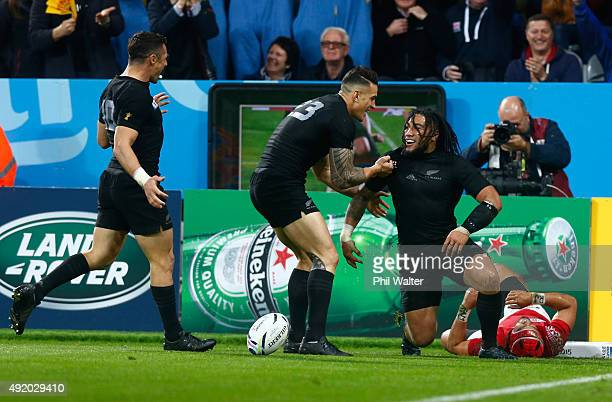 Ma'a Nonu of the New Zealand All Blacks celebrates with teammate Sonny Bill Williams after scoring their seventh try during the 2015 Rugby World Cup...