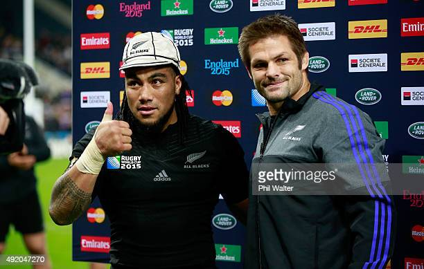 Ma'a Nonu of the New Zealand All Blacks is presented with his 100th cap by teammate Richie McCaw after the 2015 Rugby World Cup Pool C match between...