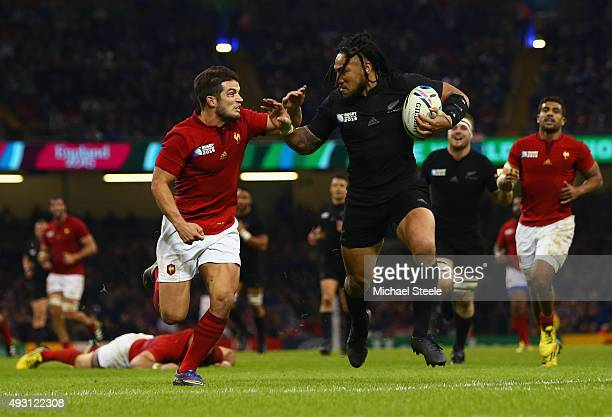 Ma'a Nonu of the New Zealand All Blacks tries to hand off Brice Dulin of France during the 2015 Rugby World Cup Quarter Final match between New...