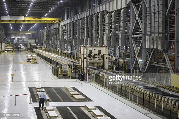 A Ma'aden worker stands inside the aluminium rolling mill at the Ras Al Khair Industrial City operated by the Saudi Arabian Mining Co in Ras Al Khair...