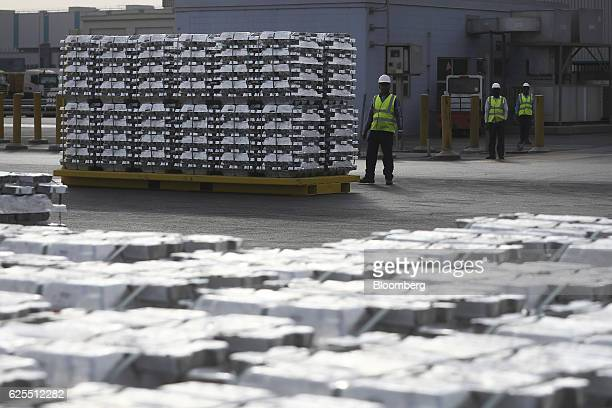 Ma'aden workers prepare to move pallets of aluminium ingots from the aluminium processing area at the Ras Al Khair Industrial City operated by the...